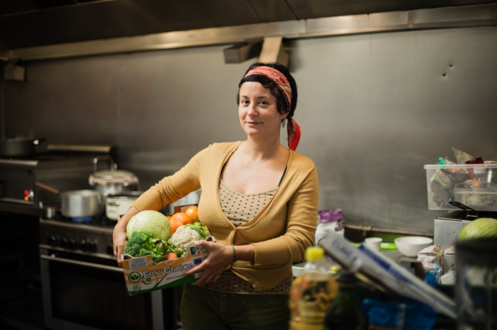 Brigida, founder of Dinner Exchange East carries some of the food they have gathered from local markets - saving it from the bin